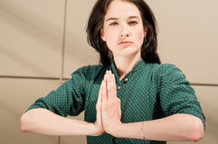 Female model holding palms together as praying Royalty Free Stock Photography