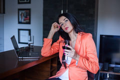Female model holding wineglass full of red wine. Royalty Free Stock Photos