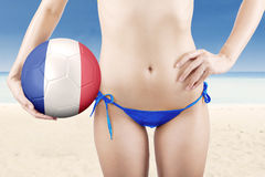 Female model holds ball at coast Royalty Free Stock Photography