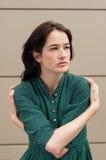 Female model hugging herself Stock Image