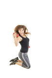 Female model in jump flexing and showing muscles with weights stock images
