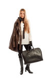 Female model with leather jacket and black handbag posing Stock Photography