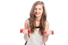 Female model lifting small red weights Royalty Free Stock Photos