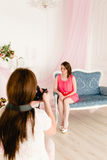 Female model and photographer in a photoshooting royalty free stock images