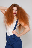 Female model playing with frizzy hair stock photography