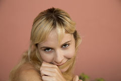 Female model portrait close up playing with her hair Royalty Free Stock Photography