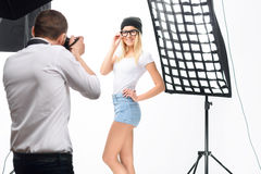 Female model poses professionally during. Well-trained posture. Young appealing female model poses skillfully while being photographed royalty free stock photography