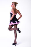 Female model posing in black and pink dress Royalty Free Stock Photo