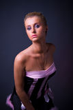 Female model posing in black and pink dress Royalty Free Stock Images