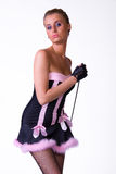Female model posing in blak and pink dress Stock Images