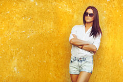 Female model posing outdoor by the wall Stock Images