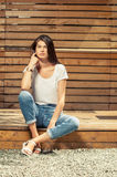 Female model posing outdoor wearing jeans and t-shirt Stock Images
