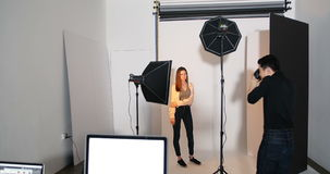 Female model posing for a photo shoot. In the studio stock video footage