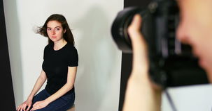 Female model posing for a photo shoot. In the studio stock footage