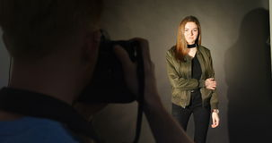 Female model posing for a photo shoot. In the studio stock video