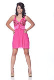 Female model posing with a white background. Caucasian teenage female posing wearing a pink cocktail dress with a white background Royalty Free Stock Photos