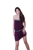 Female model in purple short dress Royalty Free Stock Image
