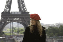 Female model in red hat Eiffel tower background Royalty Free Stock Photography