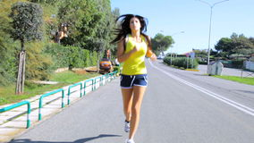 Female model running on street in summer Stock Photography
