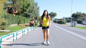 Female model running on street in summer stock video