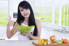 Female model with salad and OK sign Royalty Free Stock Image