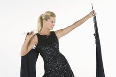 Female Model Selecting Dress Royalty Free Stock Image