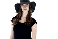 Female model with a serious expression wearing a black top Royalty Free Stock Photos