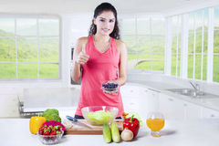 Female model shows thumb up with superfood Royalty Free Stock Images