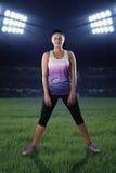 Female model with sportswear at stadium Royalty Free Stock Image