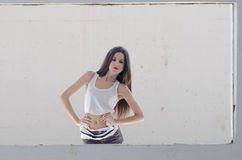 Female model standing behind of a cement window Royalty Free Stock Photo