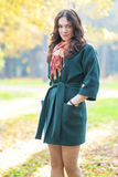Female Model Standing In Fall Forest Outdoors royalty free stock images