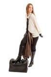 Female model stepping on black leather bag Stock Image
