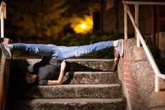 Female model stretching her legs on stairs Stock Photos