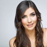 Female model studio posing.Beauty smiling woman face portrait. Close up girl face stock photo