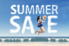 Female model with summer sale cloud Royalty Free Stock Photo