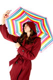 Female model taking selfie with colorful umbrella Royalty Free Stock Images