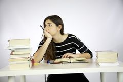 Female model thinking while studying Stock Image