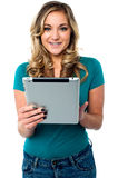 Female model using tablet pc Stock Photo