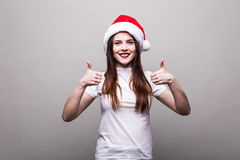 Female model wear santa hat with okey gesture. Beautiful female model wear santa hat with okey gesture Royalty Free Stock Photo