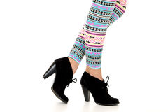 Female model wearing ankle boots and colorful legg Royalty Free Stock Photos