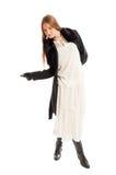 Female model wearing black coat and white dress Royalty Free Stock Photos