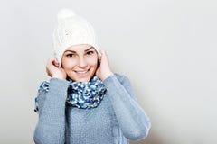 Female model wearing a blue woolen sweater Stock Images
