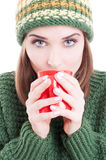 Female model wearing knitted clothes and drinking tea Royalty Free Stock Images