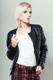 Female model. Wearing leather jacket and red scarf posing fashion in the studio Royalty Free Stock Image