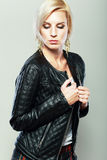 Female model. Wearing leather jacket and red scarf posing fashion in the studio Stock Photos