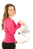 Female model wearing pink holding an American football helmet Stock Images
