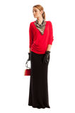 Female model wearing red blouse and long black skirt Royalty Free Stock Photography