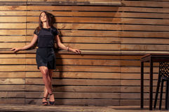 Female model wearing skirt and black t-shirt posing outdoor royalty free stock photography