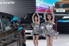 Female models dancing at kia car booth Stock Photo