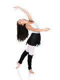 Female modern dancer. Beautiful female modern jazz contemporary style dancer isolated on a white background. Dancer is wearing a blue leotard, black skirt and royalty free stock photo